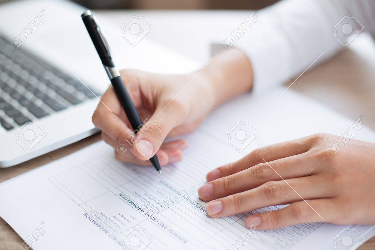 Cropped View Of Person Holding Pen And Filling Out Application with Person Filling Out Form 24643